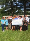 100 Men Club Donates $14k to Bloomfield SCAMP
