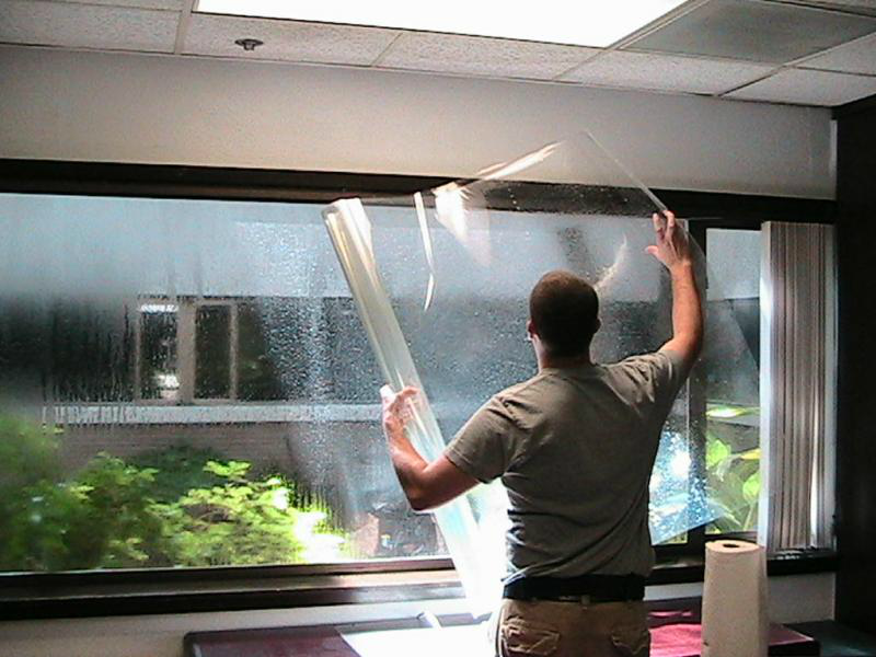 Glass film being installed