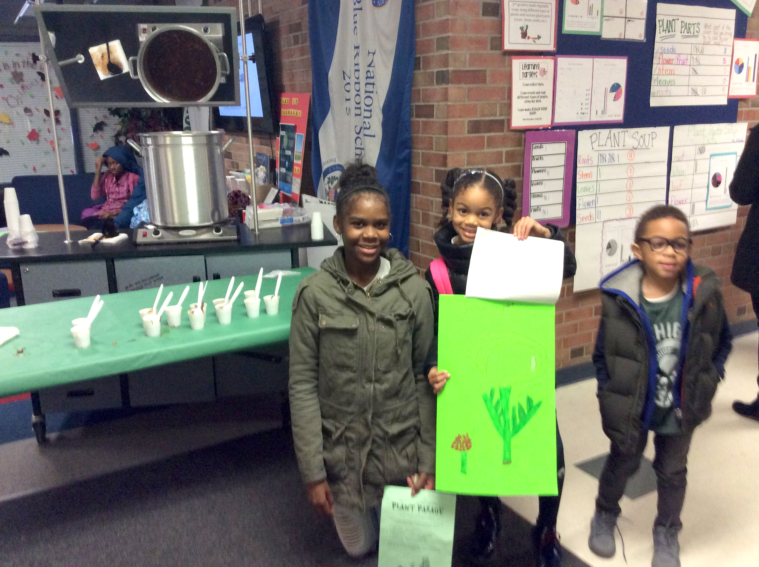 Students with plant grown project