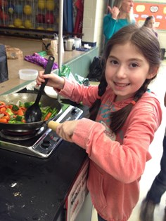 Elementary School Student Learning to Cook at Eastover Elementary, Michigan